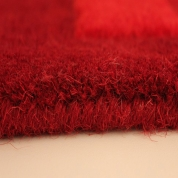 Tapis Pebbles rouge par Angelo